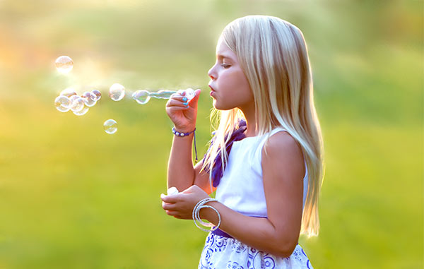 painted-portrait-of-girl-blowing-bubbles
