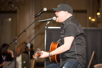 Greg Stryker sings for charity