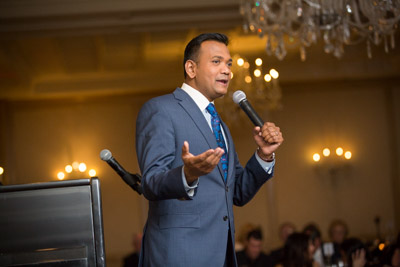 Roop Raj of Fox 2 hosts the FAR charity event.