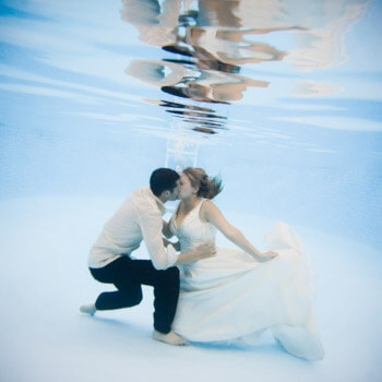 Bride and groom underwater. Hugh Anderson Photography, Metro Detroit.