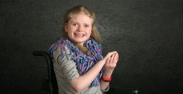 Photographing children. Girl in a wheelchair portrait