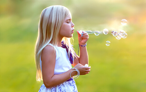 Ad Image. Young girl blowing bubbles. Hugh Anderson Photography