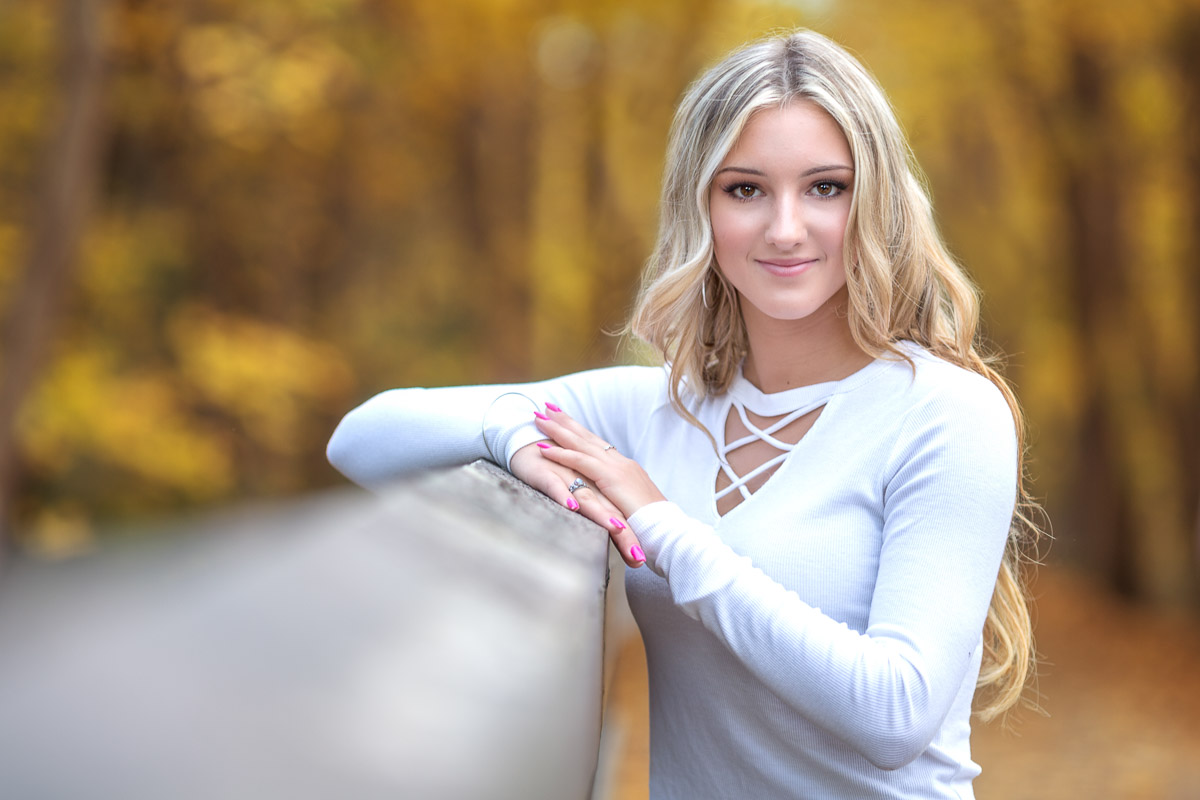 Senior pictures. High school senior photos of Dakota in fall colors by Hugh Anderson Photography